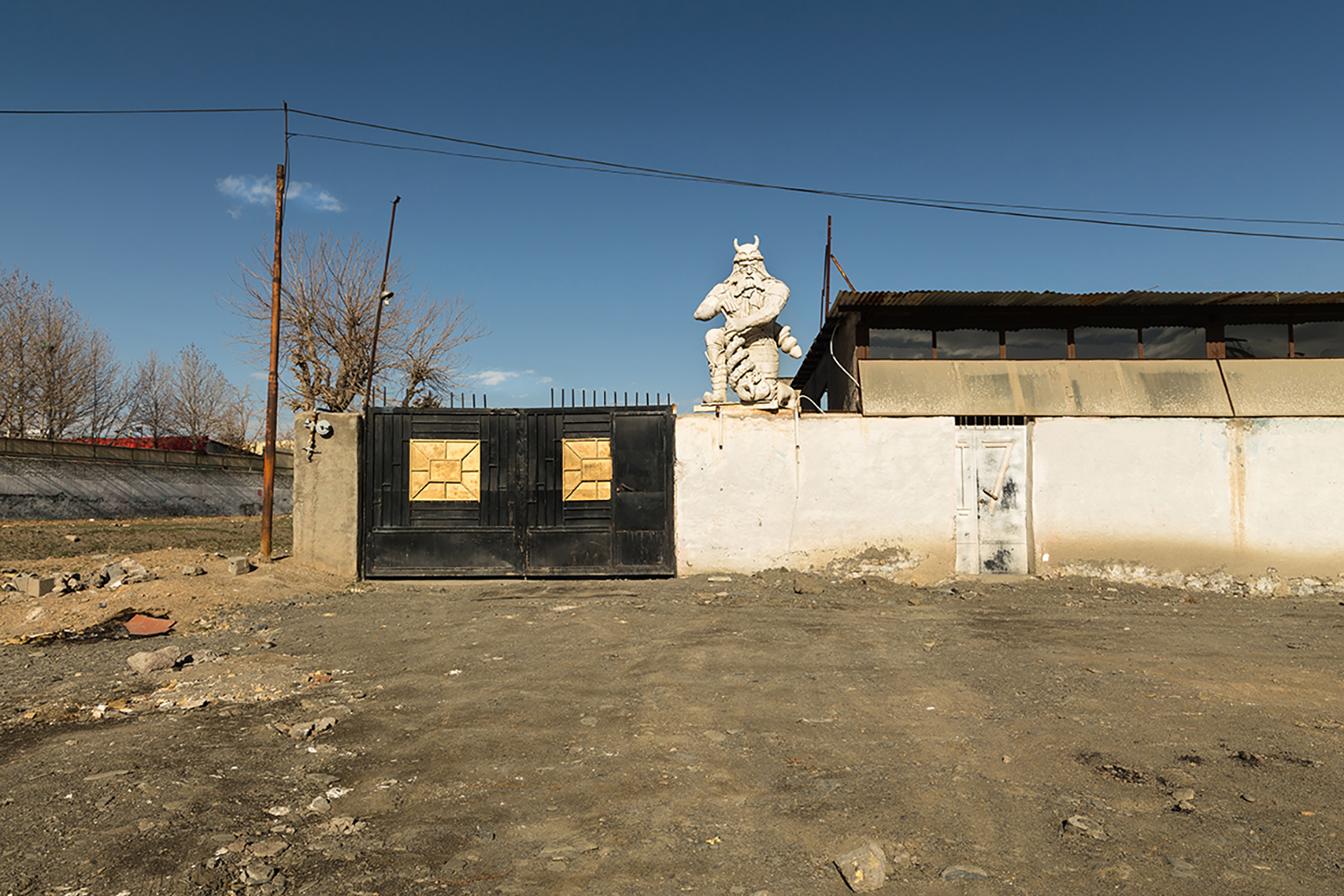 The statue of Rostam( or Rustam , son of Zal and Rudaba, the most celebrated legendary hero in Shahnameh and Iranian mythology), is placed on the wall of a house. Shandiz, Iran.