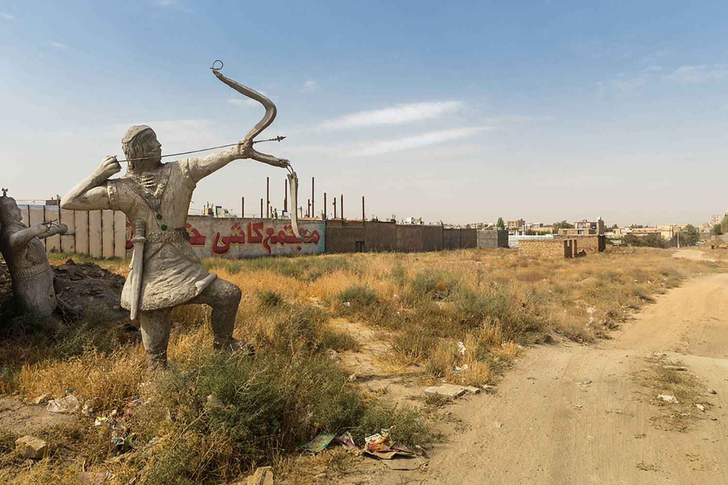 The sculpture of Arash the Archer who is a heroic archer-figure of Iranian mythology. It has been abandoned in roadside due to obsolescence, Chenaran, Iran.