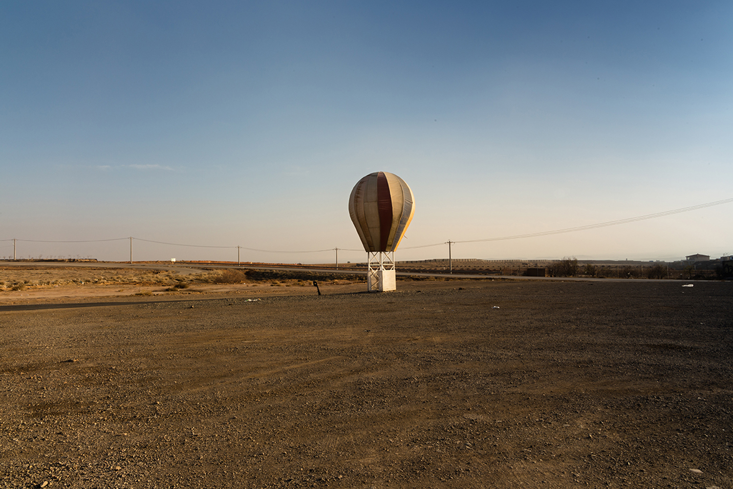 Alongside the road to Neyshabur from Mashhad. The sculpture of balloon, which has been abandoned in roadside due to obsolescence, Neyshabur, Iran.