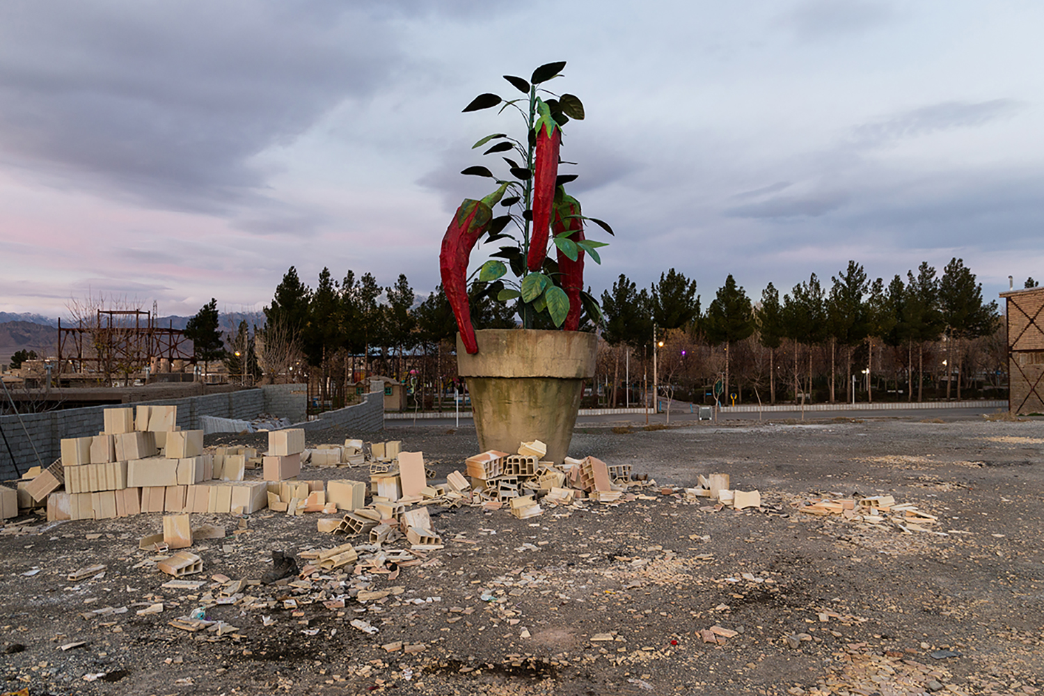 The sculpture of pot and its red chilly, abandoned in Davarzan city's St., Iran.