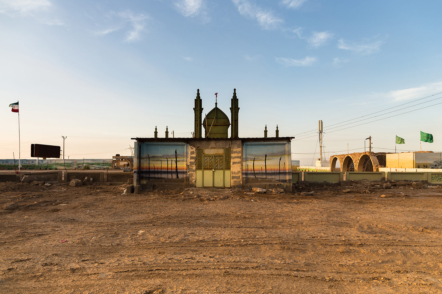 The symbolic mosque was placed in Shalamcheh. The picture of sunset was painted to indicate the sunset of south which seems to last an eternity.
